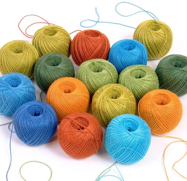 Group of multi-color yarn clews with tangled threads isolated on white